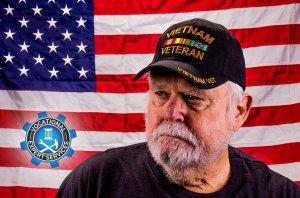 Vietnam veteran in front of United States flag