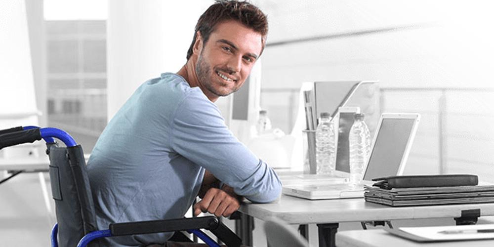 personal injury disabled man sitting at desk